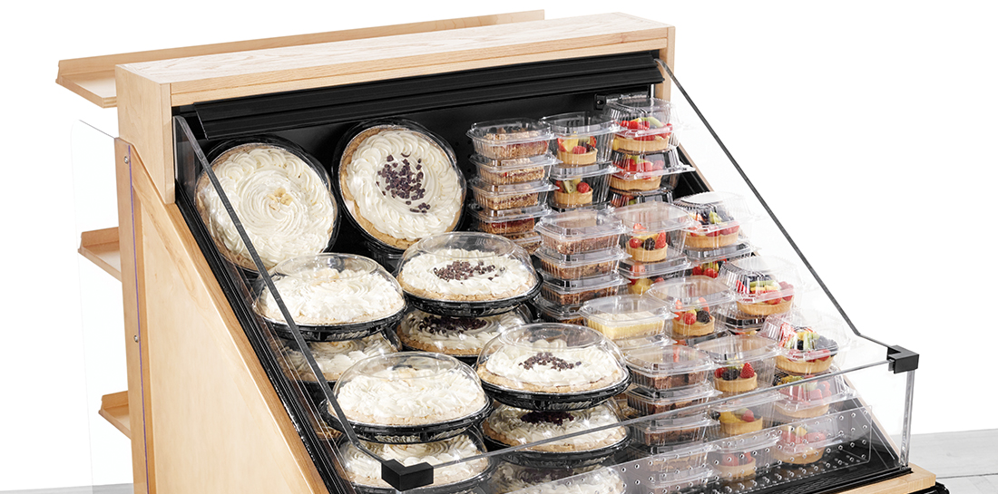 Grocery or bakery refrigerated pastry display case with shelves for additional merchandising.