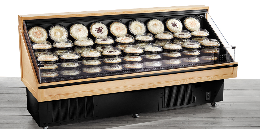 Refrigerated pastry display case for grocery or bakery.