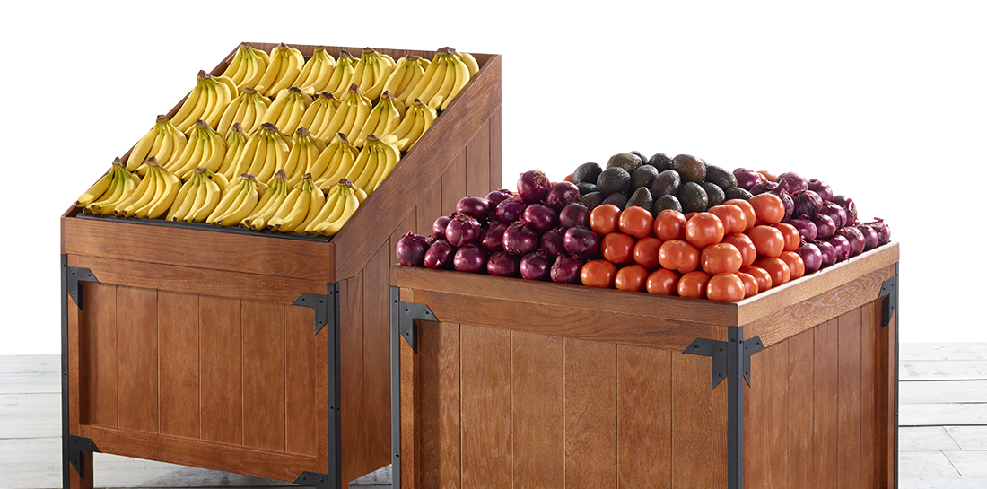 Grocery store slant bin and orchard bin for produce, displaying a variety of fruits and vegetables.