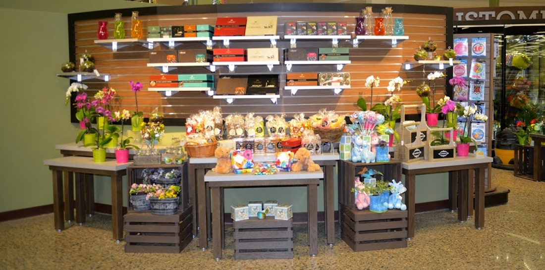 Nesting table displays in the floral department of a grocery store, perfect for showcasing flowers, gifts and more.