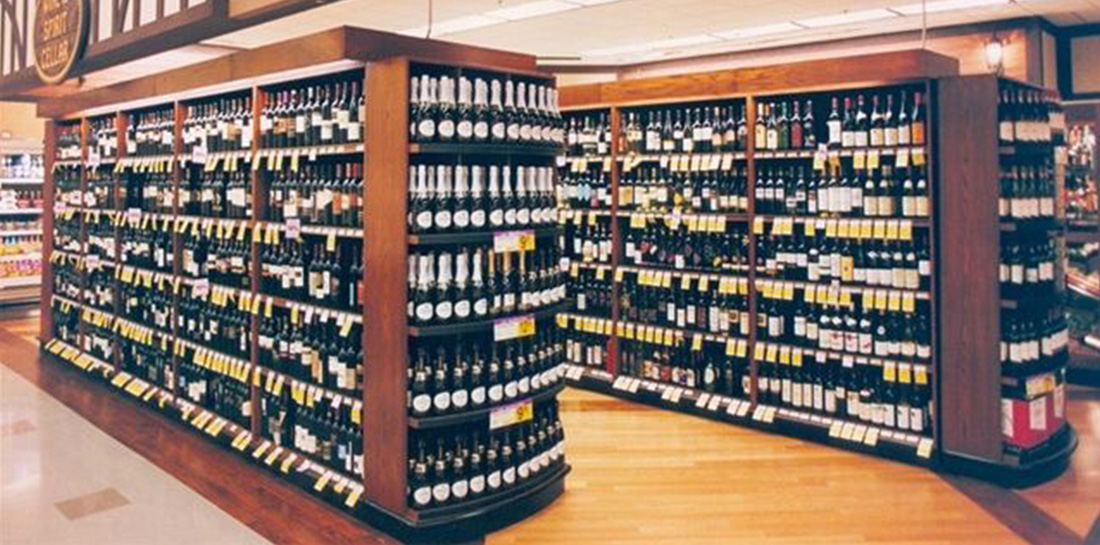 Shelved wine display cases and end caps, designed for use in grocery stores, liquor stores, package stores or wine shops.