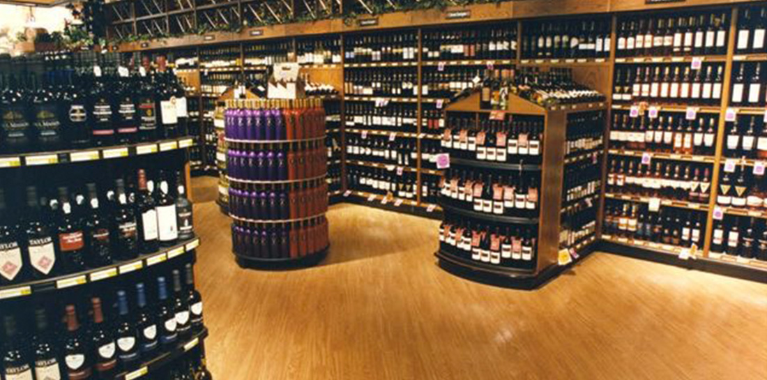 Wine displays for use in grocery stores, liquor stores, package stores or wine shops, featuring a wall display with shelves and bins, shelf units with endcaps, freestanding island displays and more.