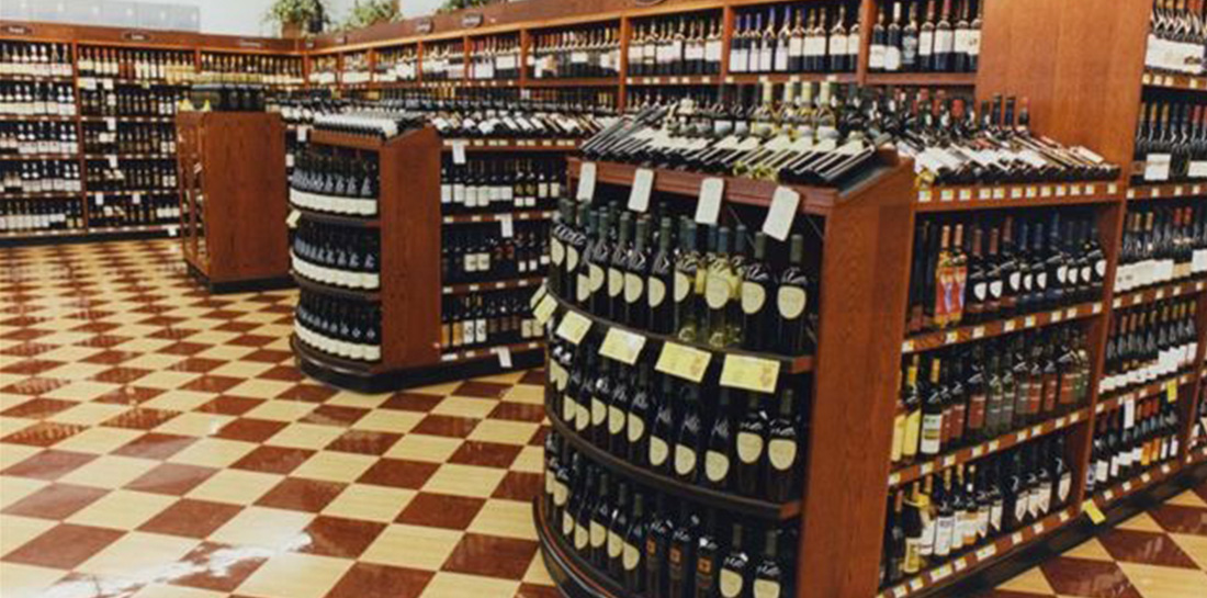 Wine displays for use in grocery stores, liquor stores, package stores or wine shops, featuring a wall display and shelf units with endcaps.