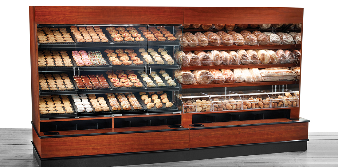 Pastry and bread display cases for grocery stores or bakeries. Pastry case has glass doors and dispensers for wax paper and bags. Bread case has areas for packaged goods and bulk goods.