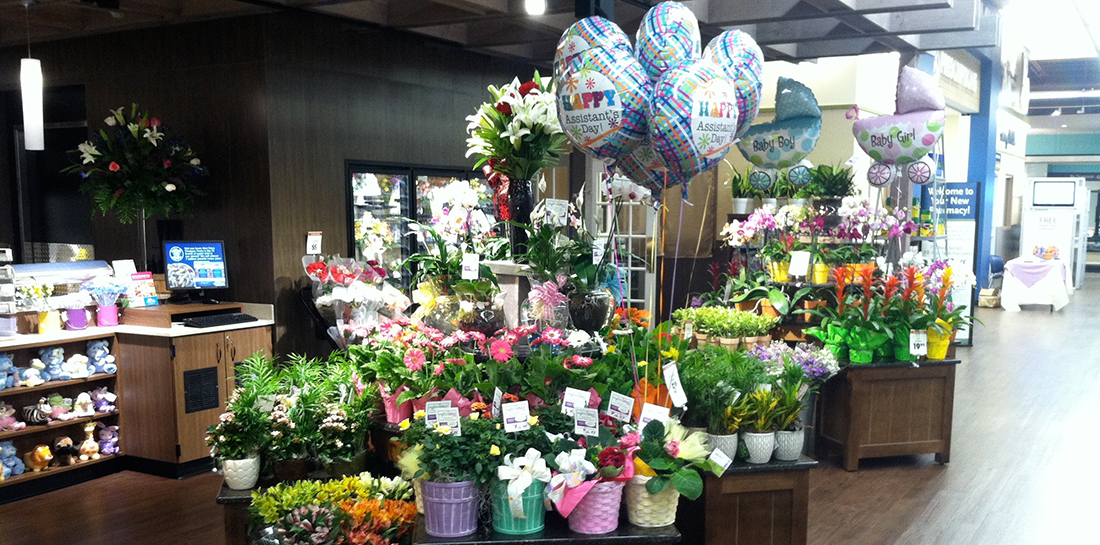 Freestanding floral display for grocery store to showcase potted plants, grab-and-go bouquets, cut flowers and gifts.