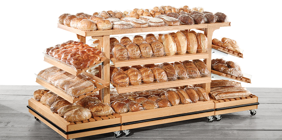Shelving island display with center section and endcaps with shelves for packaged baked goods and breads in a grocery.