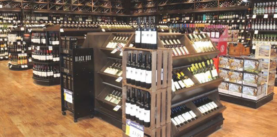 Wine displays for use in grocery stores, liquor stores, package stores or wine shops, featuring a wall display with shelves and bins and shelf units with endcaps.