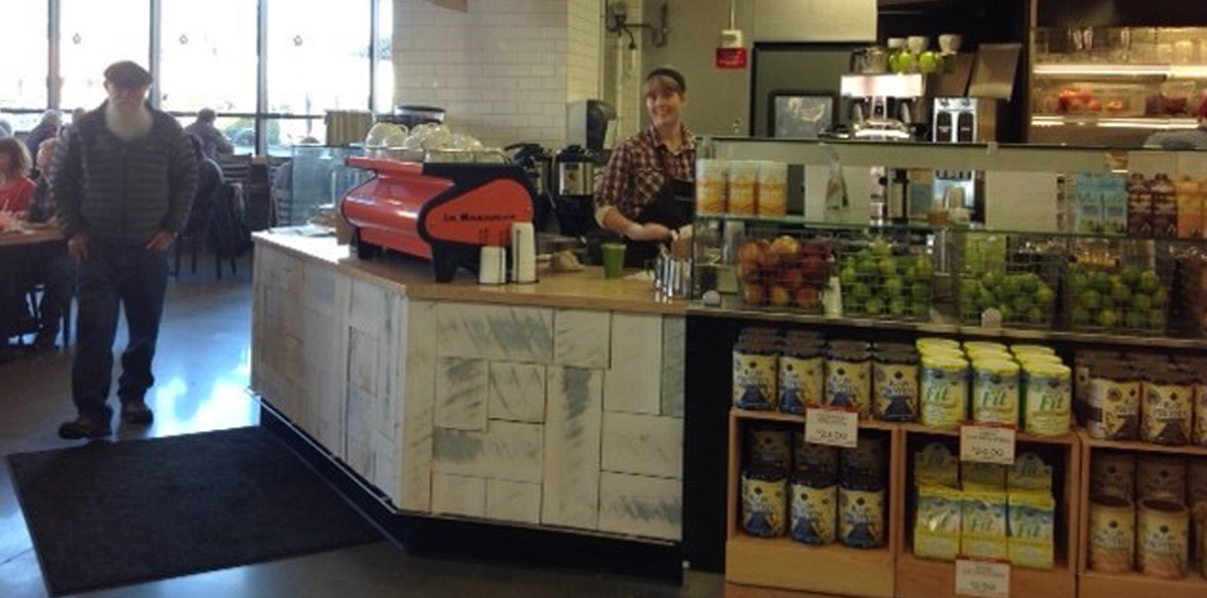Coffee shop, smoothie bar or deli sandwich counter in a grocery store with a restaurant.