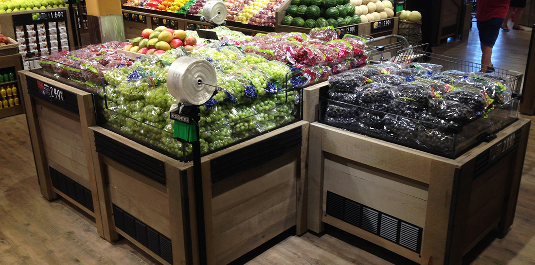 Grouping of refrigerated produce display case for showcasing grapes in a grocery store.